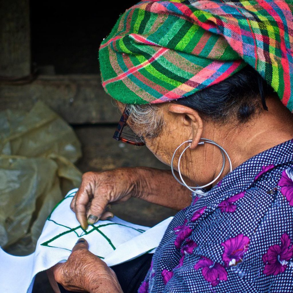 Seeing is believing An elderly Black Hmong woman concentrates onhellip